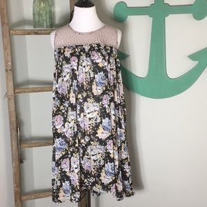 Navy Floral swing dress with lace detail.